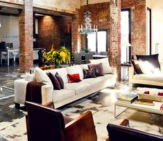 Exposed brick and stained concrete.