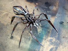 Scissor Spider Sculpture from TSA confiscated scissors. by Christopher Locke