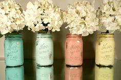 Hello, centerpieces! So pretty! Painted mason jars with beautiful blooms.
