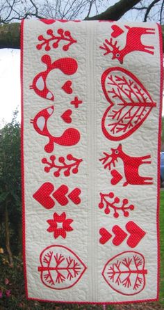 Nordic Christmas Table Runner Pattern by Frangipani Fabrics (Australia). Applique and sew this Nordic style tablerunner by hand or machine in cotton fabrics, or wool felt. A Moira Bevan design.