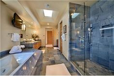 amazing bathroom.  Love how you can see the tv from the shower