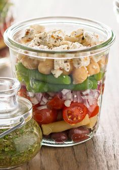 Layered Bean Salad with Feta — Layered with colorful beans, crumbled feta and Italian dressing, this recipe is prepared in canning jars for easy picnic-cooler packing.