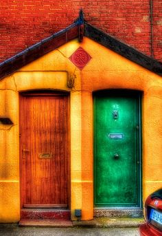 Two doors in a yellow wall.