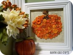 Pumpkin Button Art – Do you have any old picture frames laying around that need to be rehabbed?   How about some burlap with buttons?
