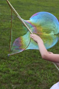 Make your own giant bubble wand.