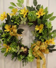 Bird and Butterfly Wreath green daisies and hydrangeas and yellow poppies.
