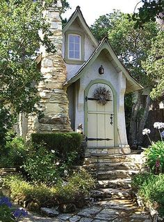 how cute is this. . . .love the stone stacked fireplace. . . .now, I want to see the inside!