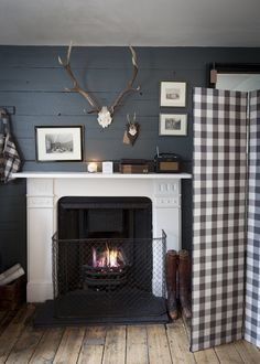 checks, antlers, fireplace