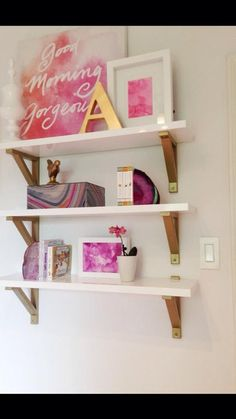 Project Nursery - White and Gold Shelves with Fuchsia Accents