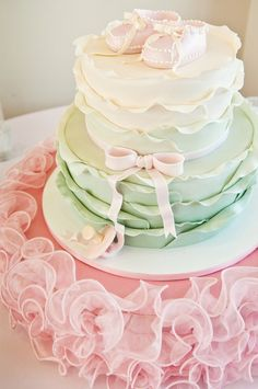 ahhh.. love this !! Ruffled baby shower cake with mint green ombre layers and a pretty pink bow