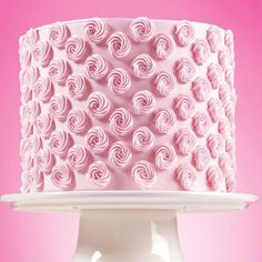 Pretty rose-colored rosettes cover this party cake. Easy to make, simply ice cake in buttercream and pipe a pattern of rosettes on the sides. Serve at bridal showers, girl's birthday party, or as a special dessert for friends.