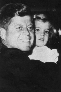 John F. Kennedy and daughter Caroline, 1960.