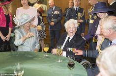 Proud: A former Spitfire pilot, his chest covered in medals, told the royal couple of his ...