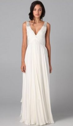 Beach wedding dress. Simple and elegant! It definitely has a Greek Goddess feel.