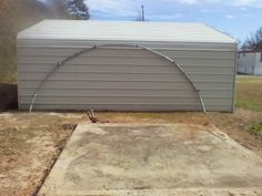 Another use for the trampoline frame. Take the round frame apart so that you have two semi circles and stand them upright. Install conduit in the pipes where the legs were and add a tarp. It's a quick and easy Quonset building. Trampolines are usually 14' diameter and that makes a 10x14x7 shed. That'll cover quite a few tractors. I've also used the original legs to lift it two feet on the four corners to give a nine foot peak.