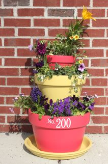 Awesome stacked tiered planter DIY. Easy, beautiful & personal with the addition of your address or family name from tradingphrases.com