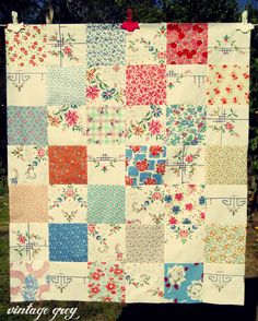 vintage grey: quilt top with squares of vintage embroidery