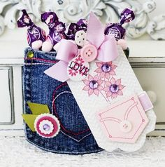 Jean Pocket Gift Bag- Snipp the pockets out of old jeans and create a gift bag of sorts.  The size is perfect for candy, fingernail polish, a card, a homemade cookie, etc.