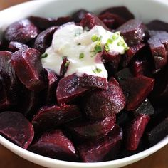 Roasted beets and beet greens with spicy horseradish cream. Holy cats, that looks good.