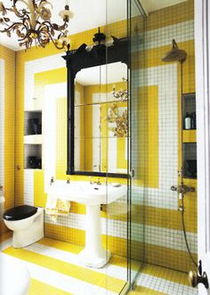 Now that is a cheerful mosaic tiled bath! World of Interiors August 2011