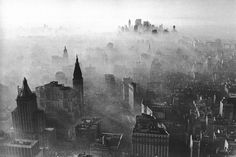 Midtown and Lower Manhattan covered in smog. 1966. New York
