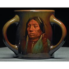 """Rookwood handled vessel, Standard glaze with a Native American portrait, """"Pacer', Apache"""", executed by Sturgis Laurence in 1898, #830E, 6""""w x 4.75""""h, harmless line to rim"""