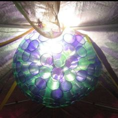 Homemade mardi gras themed lantern made with purple and green party cups