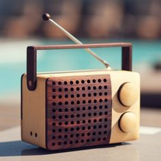 Traditional craft meets retro modern design. This wooden radio and MP3 player, designed by Singgih Kartono, is hand-crafted in a farming village in Indonesia from new-growth wood. For each tree that is used in the production of the radios, a new tree is planted