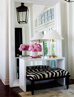 entry way.... Love the oversized mirror... Anndddd the peonies ;)