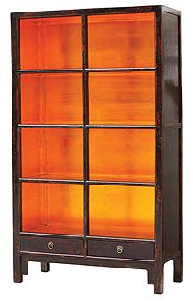 like how it glows: copper leaf lined bookcase and gloss black exterior