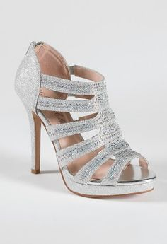 "High heel sparkle sandal features:• 4.5"" heel• 1"" platform • Zipper back closure• Padded insole• Medium width only"