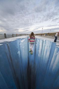 The 3D street painting 'Crevasse' by artist Edgar Mueller .