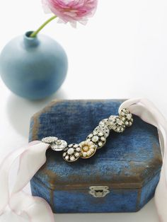 DIY:  Extremely easy bracelet made from vintage buttons.