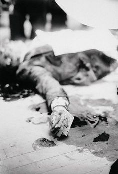 """A picture ofJoe Masseria, a mob boss, taken in 1931 after being murder by supposedCharles """"Lucky"""" Luciano's hitmen.    Aphotographer decided to stage the crime sceneand take the ace of spades card that Masseria was playing with before his murder, and put it in his hands.And since then, the mob has always thought the Ace of Spades as a bad omen."""
