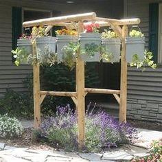Hanging container garden http://media-cache9.pinterest.com/upload/8796161742335544_18cvJG0l_f.jpg http://bit.ly/Htuyzo sailchic gardening