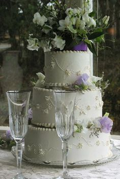 Champagne flutes and wedding cake.