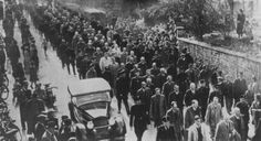 """Guards force Jews, arrested during Kristallnacht (the """"Night of Broken Glass""""), to march through the town of Baden-Baden, Germany. November 1..."""