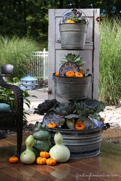 Create a beautiful fall planter from galvanized bins and an old door!!! Bebe'!!! Great idea for the fall garden decorations!!!