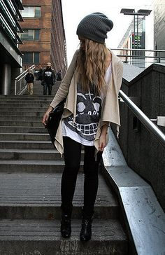 Beanie, open cardigan, graphic tee, leggings, ankle boots.
