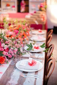 Lush floral place settings & rustic tables