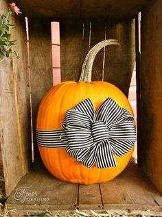 Fall porch decorating ideas- Add a May Arts Ribbon bow to your pumpkin for a unique look