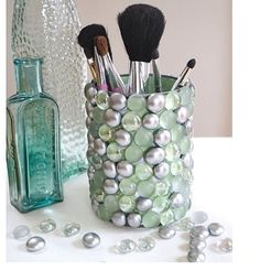 Make-up holder DIY: use soup cans and marbles glue then on with a hot glue fun