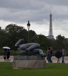 Nude Statue and Umbrellas with the Eiffel Tower in the Background