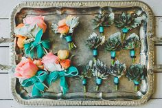 succulent boutonnieres and corsages, photo by Jason Hales Photography http://ruffledblog.com/fernbank-museum-wedding #weddingideas #flowers #groomsmen