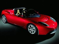 Cool ELECTRIC super car -- the Tesla Roadster. Who says going green is for the birds?