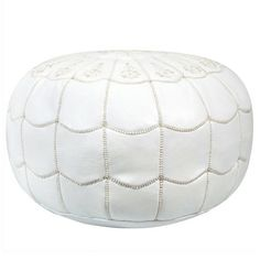 Handmade leather pouf with a white arch motif.Product: PoufConstruction Material: Moroccan leather and shredded foam f...  https://www.jossandmain.com/White-%26-Wood-Tamar-Leather-Pouf-in-White~HHND1023~E6727.html