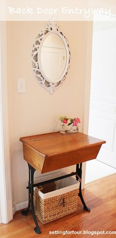 Small space makeover! See how a small space was transformed into an organized entryway with vintage mirror, antique desk and a basket for storage!