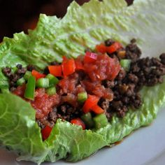 Taco meat and veggies in a lettuce wrap