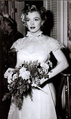 A rare photo of Marilyn pictured in a Elois Jenssen design for We're Not Married, which did not make the film in 1952.