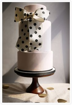 Light pink cake with polka dot bow.